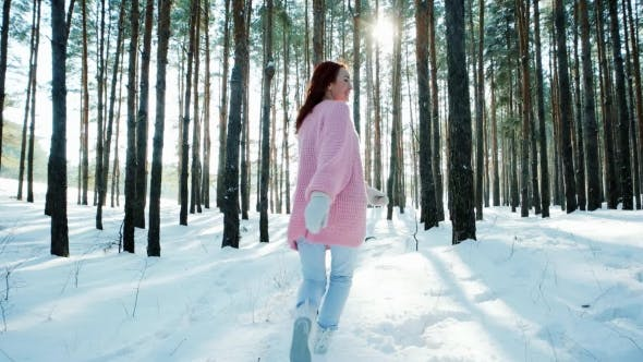 Thumbnail for Happy Young Woman in a Winter Forest