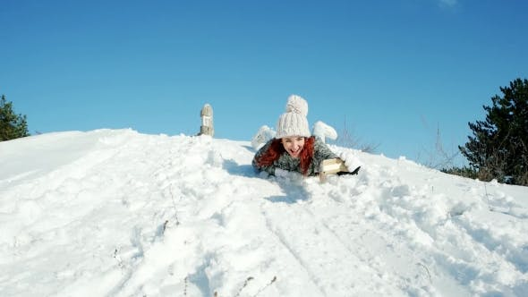Thumbnail for Happy Girl Riding on a Sledge Makes the Photo Selfie, Winter Crazy Photo, Woman Holding a Cell Phone