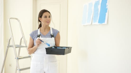 Thumbnail for Young Woman Decorating Her Home