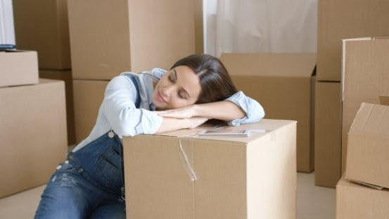 Thumbnail for Young Woman Taking a Nap on a Brown Carton