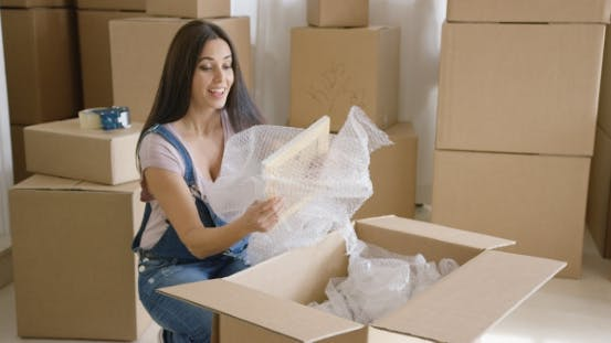 Thumbnail for Smiling Happy Woman Packing Up Her Home