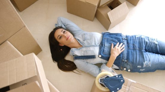 Thumbnail for Attractive Young Woman Relaxing on the Floor