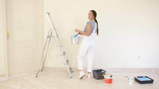 Young Woman Doing DIY Renovations