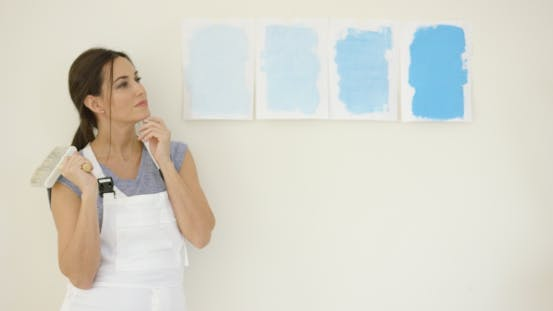 Thumbnail for Young Woman Choosing a New Paint for Her Home