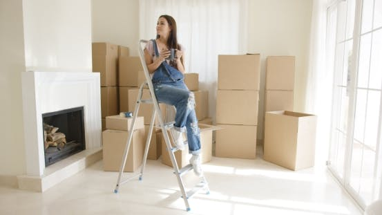 Thumbnail for Young Woman Sitting on a Stepladder