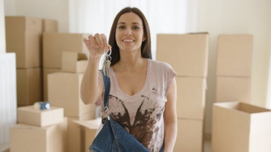 Thumbnail for Proud Young Woman Holding Up a Set of House Keys