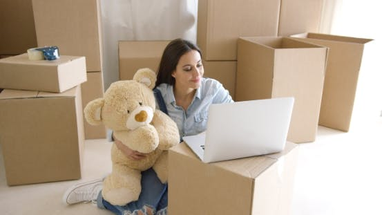 Thumbnail for Young Woman Moving House with Her Teddy Bear