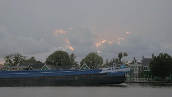 Thumbnail for Barge Sailing By the Village Houses