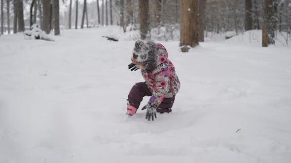 Thumbnail for Beautiful and Cheerful Child, Running Happily Through the Snow, Which Only Recently Fell