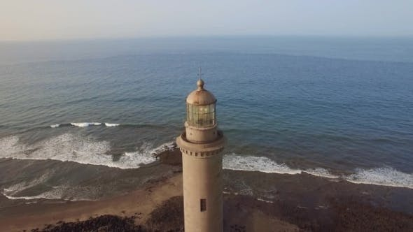 Thumbnail for Flying Over Maspalomas Lighthouse and Ocean
