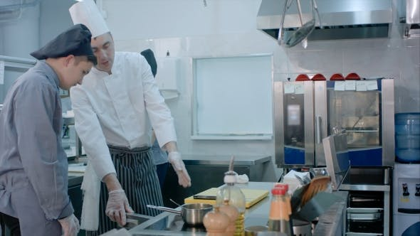 Thumbnail for Male Mature Chef Showing His Trainee Around the Kitchen
