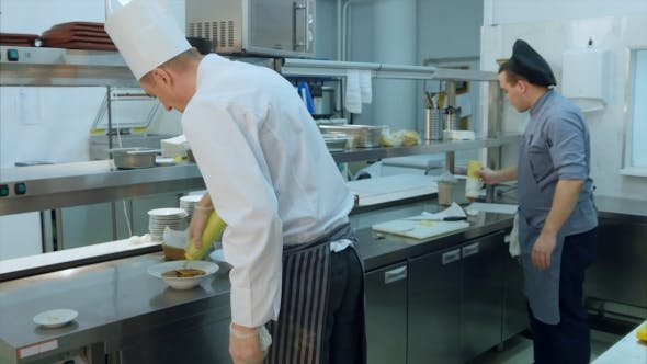 Thumbnail for Chef and Cook Pouring Sauces for Prepared Dish