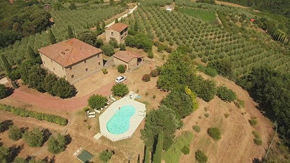 Rotating Drone Footage of Holiday House and Swimming Pool