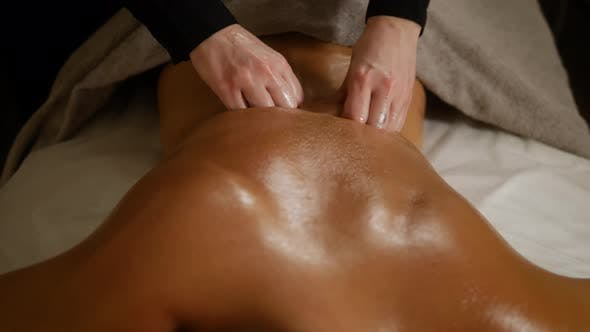 Thumbnail for Close Up Therapeutic Massage of the Female Shoulders and Neck. Male Hands Doing Professional Massage