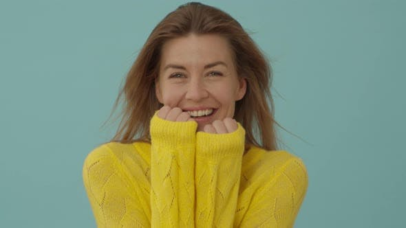 Thumbnail for Woman in Yellow Top Laughing