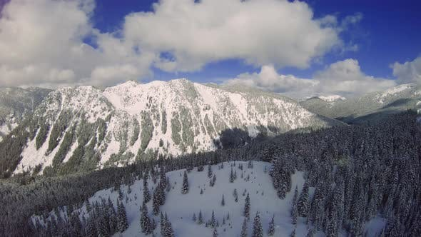 Thumbnail for Aerial Reveal Of Snow Covered Mountain Valley In Washington State