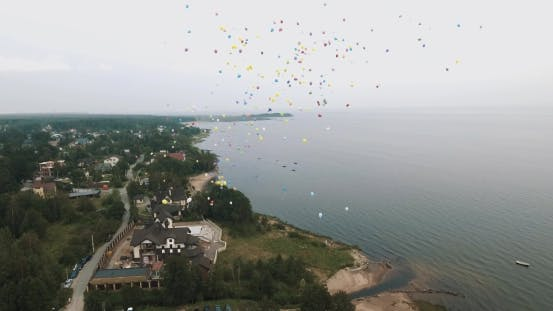Thumbnail for Aerial Shot Lots of Colorful Balloons Flying Up in To Sky Over Sea Shore Beach