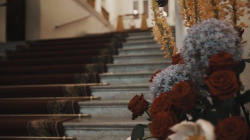 Staircase with Carpet, Old Classical Conert Hall Hallway, Roses on Foreground