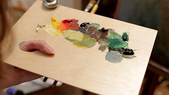Thumbnail for Artist Mixing Oil Colors On A Palette