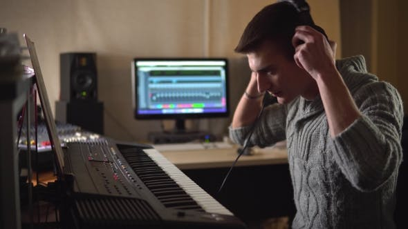 Thumbnail for A Professional Composer Composes Music on an Electronic Piano in the Studio
