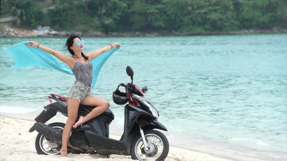 Thumbnail for Young Woman on Motorbike with Cloth Waving in Hands