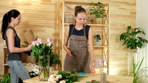 Thumbnail for Female Florists Unpacks Roses, Preparing Flowers for Making Festive Bouquets, Beautiful Girl Florist