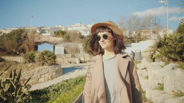 Thumbnail for Attractive Girl Walks Near Shore Line in Small Mediterranean Town