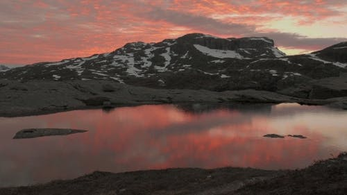 Sunset Over the Mountains Lake. Trolltunga Area, Norway.