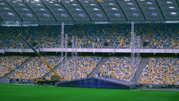 Thumbnail for View on the Football Stadium with Workers.