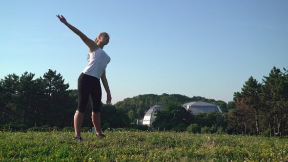 Cover Image for Girl Enjoy Exercises for Flexible in Park.