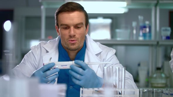 Thumbnail for Researcher in Lab. Scientist Man with Pipette in Lab. Scientist Student