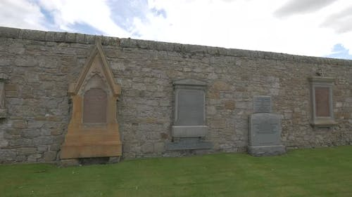 Tombstones in a stone wall