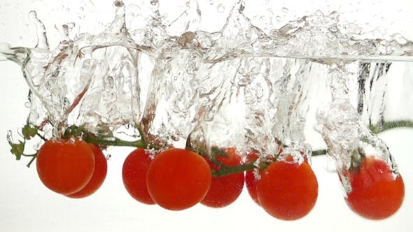 Thumbnail for Whole Tomatoes Falling Through Water.