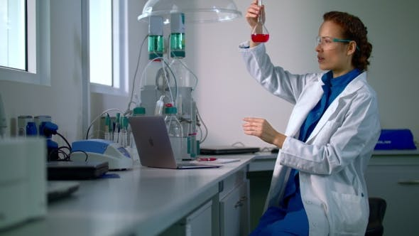 Thumbnail for Woman Scientist Studying Chemical Liquid in Lab Flask. Chemical Engineering