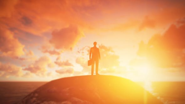 Thumbnail for Young Businessman Standing On the Hill - Sunset