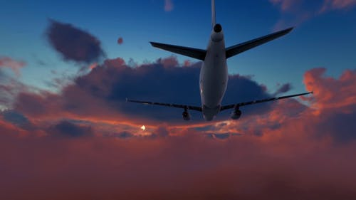Plane Takes Off At Sunset