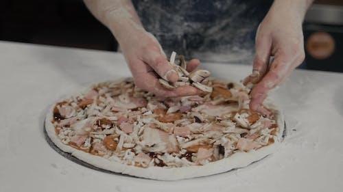 Chef Making a Pizza in Modern Italian Restaurant