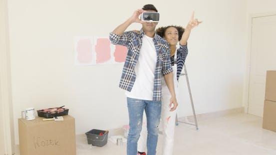 Thumbnail for Man Using Virtual Reality Glasses Gets Help