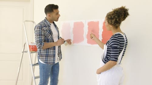Young Couple Debating a New Paint Color