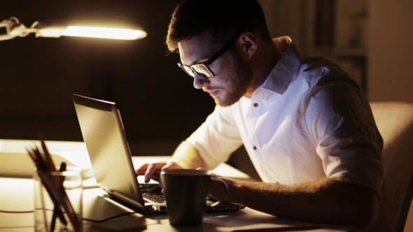 Thumbnail for Man with Laptop and Papers Working at Night Office 82