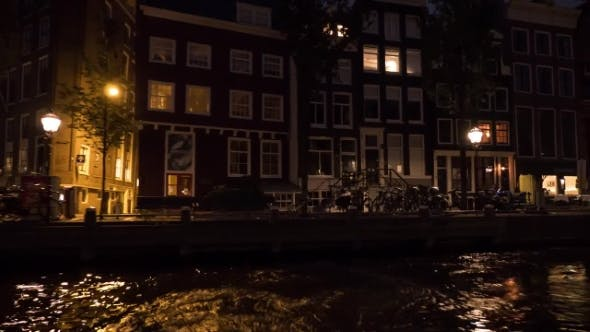 Thumbnail for View of Cityscape During River Cruise at Night, Amsterdam, Netherlands