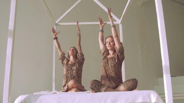 Thumbnail for Happy Calm Yoga Women Practicing Yoga Poses in Bright Studio