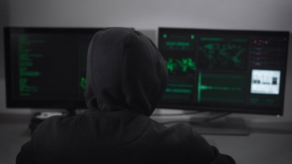 Thumbnail for Rear View on the Hacker Who Is Engaged Clandestine Cyber Attacks To the Server with the Data Bank