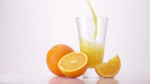 Pouring Orange Juice Into Glass