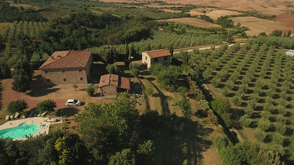 Holiday House and Fields in Tuscany on Sunny Day