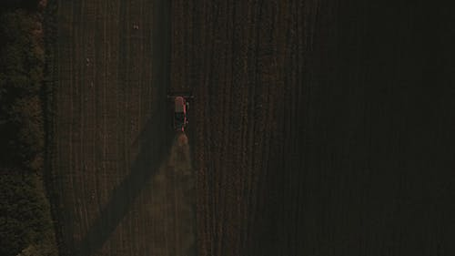 Directly Above Shot of Tractor in Crop Field