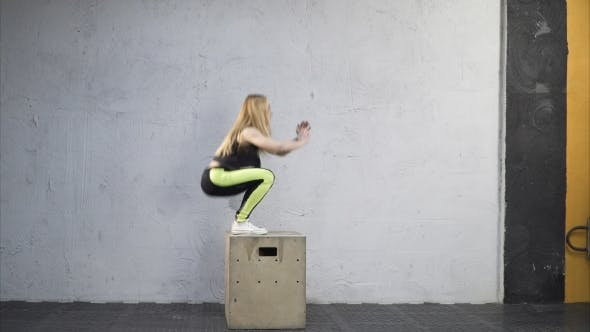 Thumbnail for Woman Jumping Up on Box in Cross Fit Gym