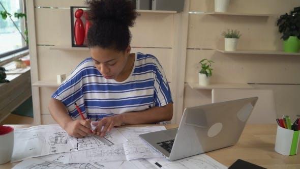 Designer Draws Plan in Blueprint.