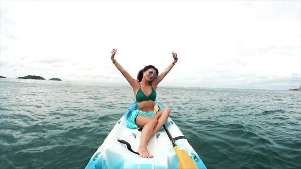 Thumbnail for Young Woman in Sunglasses Relaxing in a Boat