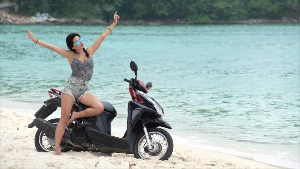 Thumbnail for Optimistic Sexy Hippie Woman on Her Motorbike